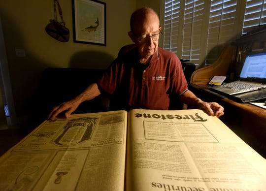 Mike Peters sits in his home in Greeley looking over some of the archived Greeley Tribune articles.