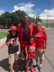 "New Mexico football player Teton Saltes poses for a picture with, from left, his grandmother Yvonne ""Tiny"" DeCory, younger brother Eric Sampson Jr., and his grandfather, Lee DeCory before a game last year in Albuquerque, New Mexico."