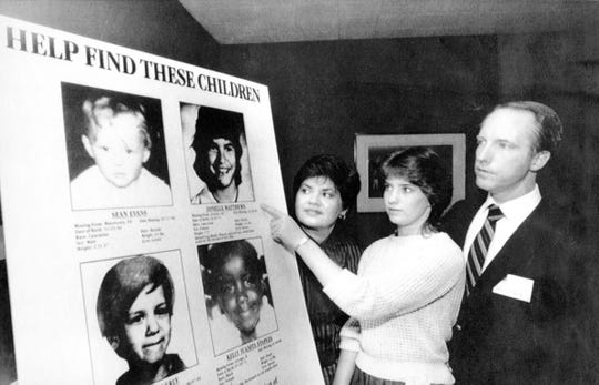 Jennifer Matthews, then 16, points to a photo of her missing sister, Jonelle, who was 12 when she disappeared, as their parents, Gloria and Jim Matthews, look on April 19, 1985, in New York. Playhouse Video announced a poster program as part of a campaign to help locate missing children that it hoped would involve 24,000 nationwide video retail outlets and be seen by 144 million customers.