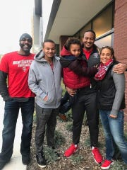New Mexico football player Teton Saltes, second from right, is pictured with his family, from left -- stepfather Eric Sampson Sr., brother Adonis Saltes, brother Eric Sampson Jr., and mother Laticia DeCory -- before a New Mexico football game last season in Albuquerque.
