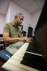 Ross Simons practices piano at his music academy in Cape Coral Tuesday, September 10, 2019. 