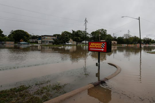 The 1900 block of Main Street is under water after heavy rains caused flooding in the area Wednesday, September 11, 2019, in Green Bay, Wis.