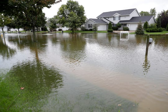 A section of Desplaine Road was under water after heavy rains caused flooding on Sept. 11 in De Pere.