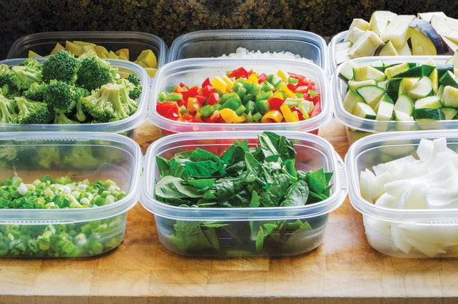 Chopped vegetables for cooking stored in plastic containers