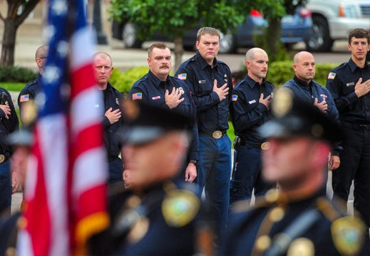 The 9/11 remembrance ceremony begins with the national anthem at Fire Station 1 in Great Falls, Wednesday morning, on the 18th anniversary of the September 11, 2001 terrorist attacks.