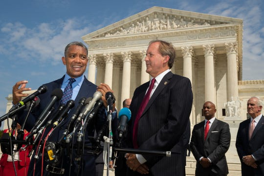 District of Columbia Attorney General Karl Racine, with Texas Attorney General Ken Paxton, right, and a bipartisan group of state attorneys general speaks to reporters in front of the U.S. Supreme Court in Washington on Sept. 9, on an antitrust investigation of big tech companies.