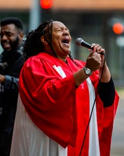"""Tracy Williams, of the Mount Olive Christian Fellowship and Alexander Temple Church of God Choir, sings """"America the Beautiful"""" during Wednesday's 9/11 remebrance ceremony at Fire Station 1."""