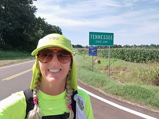 Sharon Carver takes a selfie as she enters into Tennessee from Hickman, Kentucky, at the start of the Last Annual Vol State Run. Most of the route of the 314-mile event went through the Volunteer State although it was planned to take the travelers into portions of four other states as well. (Photo by Sharon Carver)