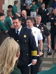 Henderson Fire Department Chief Scott Foreman and other first responders are greeted warmly by students as they exit Wendesday's special 9/11 service.