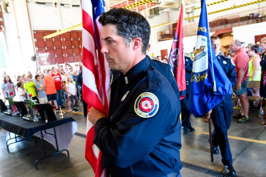 """The Henderson Professional Firefighters Honor Guard presents the colors at the """"Henderson Will Never Forget Remembrance Ceremony"""" hosted by the Henderson Fire Department at the Starlight Drive Fire Station No. 3 Thursday, September 11, 2019."""