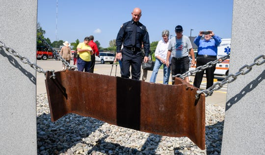 "People attending the ""Henderson Will Never Forget Remembrance Ceremony"" take pictures of the twisted piece of steel from the World Trade Center at a memorial by the Henderson Fire Department at the Starlight Drive Fire Station No. 3 Thursday, September 11, 2019."