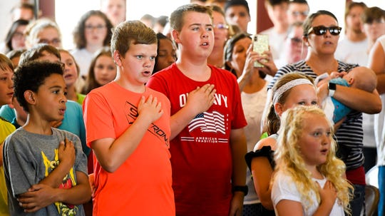 "Bend Gate Elementary School fifth-graders lead the Pledge of Allegiance during the ""Henderson Will Never Forget Remembrance Ceremony"" hosted by the Henderson Fire Department at the Starlight Drive Fire Station No. 3 Thursday, Sept. 11, 2019."