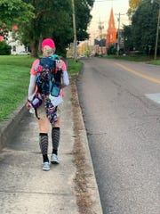 Sharon Carver walks toward the center of McKenzie, Tennessee. Ultramarathon organizer Lazarus Lake made a point to steer participants into the hearts of the many little towns they passed through on the 314-mile Last Annual Vol State Run. A change of clothes she had rinsed out hangs on the outside of her 12-pound backpack, which carried everything she took on the week-long journey.