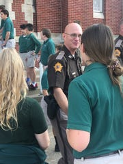 Henderson emergency officials are greeted by students after Wednesday's special Sept. 11 mass.