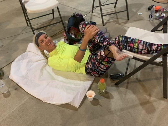 A chance to lay down — anywhere —  and elevate their weary, swollen feet is welcomed by participants in the 314-mile journey that is the Last Annual Vol State Run. This time, at an open-air farmers market in Dresden, Tennessee, was just 39 miles into the trek on the second day of Sharon Carver's 2019 participation.