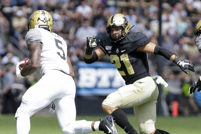 Vanderbilt running back Ke'Shawn Vaughn (5) runs the ball as Purdue linebacker Markus Bailey (21) comes in for the block during the first quarter of a NCAA football game, Saturday, Sept. 7, 2019 at Ross-Ade Stadium in West Lafayette.