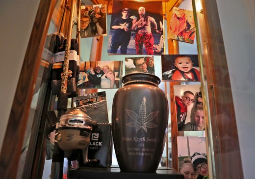 Regina Denney keeps a cabinet of keepsakes and memories of her late son, Brian Smith Jr., including the urn with his ashes, in her bedroom, Monday, Sept. 9, 2019.  Brian died in 2018 from dehydration after excessive vomiting.  The vomiting was a result of a rare condition called Cannabinoid Hyperemesis Syndrome (CHS) developed from smoking marijuana.  Denney now wants to get the word out about this rare condition.