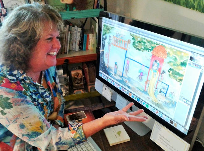 "Scanning her art into her computer allows Jennifer Black Reinhardt to quickly confer with children's picture book editors. Here, she examines a panel from her new book ""Always My Friend,"" to be released by Random House in 2021."