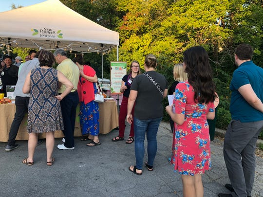 A line at the New Pioneer Food Co-op booth for tickets to the 2018 Culinary Walk.