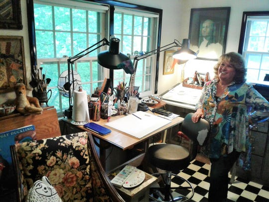 Jennifer Black Reinhardt enjoys working from her bright, slightly cluttered, eclectic art studio on the second floor of her home in University Heights.
