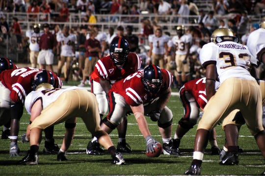 Former Ole Miss QB Micheal Spurlock (under center) now coaches wide receivers at Southeastern Louisiana.