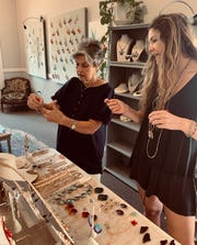 Margie Hill of Madison, left, selects jewelry with help from KK Buteau of Madison.