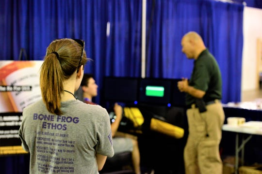 Allie Par watches as her friend  tried out the The Madison County Sheriff's Office drunk and impaired driving simulator at the West Tennessee State Fair on Sept. 10, 2019 in Jackson, Tenn.