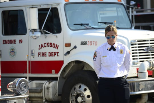 Jackson Fire Department Training Office Jana Compton bows her head to honor the victims of 9/11 during JFD's 9/11 Commemoration Ceremony on Sept. 11, 2019 in Jackson, Tenn.