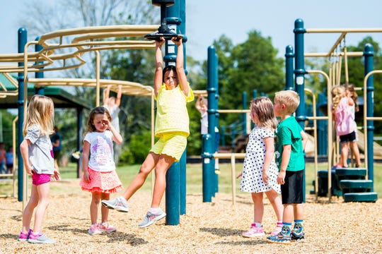 Kindergarteners at Bonny Kate Elementary in South Knoxville play on playground equipment during recess at school on Wednesday, Sept. 11, 2019.