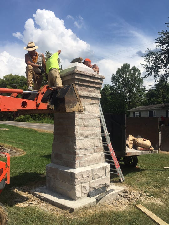 Construction workers top a pillar at Island Home Park. The construction of the new columns marks the completion of more than two years of fundraising by the Island Home Park Neighborhood Association, combined with city and county grants, donations from individual neighbors and local businesses, and material donations from others. 9/7/19