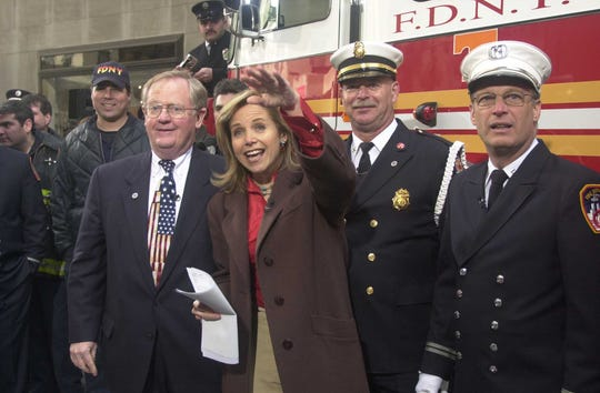 Host Katie Couric waves to the crowd after interviewing, from left, Knoxville Mayor Victor Ashe, Knoxville Fire Department Capt. Jim Stephens, and Fire Department of New York City Capt. Stephen Damato during NBC's Today Show on March 21, 2002 at Rockefeller Center. The show spotlighted Knoxville's Freedom Engine campaign which raised $950,000 for a new ladder truck for FDNY. (Paul Efird/News-Sentinel)