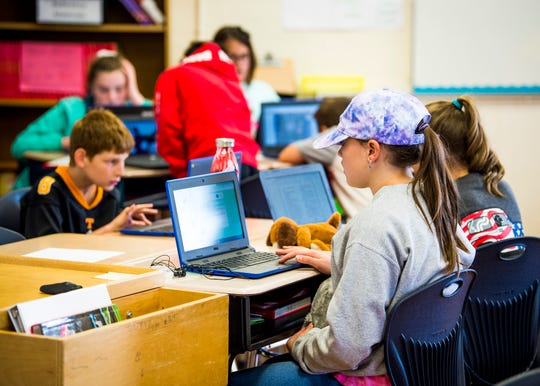 Students in Jessica Fachman's fifth grade reading class use laptops for schoolwork at Bonny Kate Elementary in South Knoxville on Wednesday, Sept. 11, 2019.