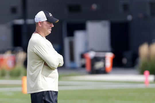 Purdue head coach Jeff Brohm watches Purdue quarterback Jack Plummer (13) throw during practice, Wednesday, Sept. 11, 2019 at Bimel Practice Complex in West Lafayette.