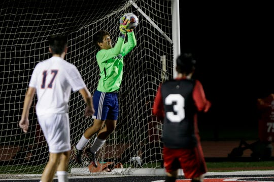 Harrison's Ayden Rubi (0) makes a save during the second period on an IHSAA boys soccer match, Tuesday, Sept. 10, 2019 at Scheumann Stadium in West Lafayette. Harrison won, 1-0.