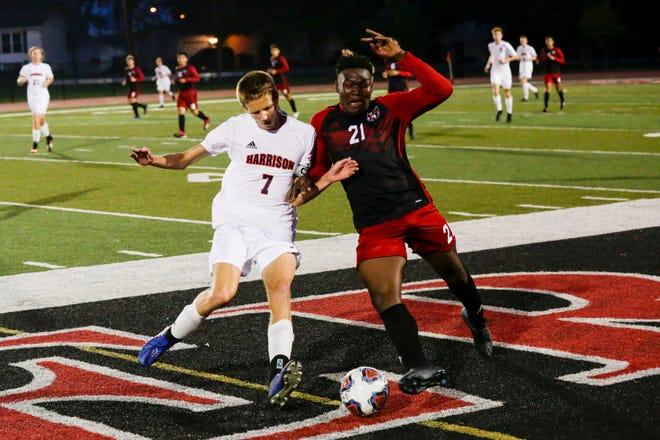 Harrison's Ben Pekarek (7) and Lafayette Jeff forward Marvens St. Felix (21) fight for the ball during the second period on an IHSAA boys soccer match, Tuesday, Sept. 10, 2019 at Scheumann Stadium in West Lafayette. Harrison won, 1-0.