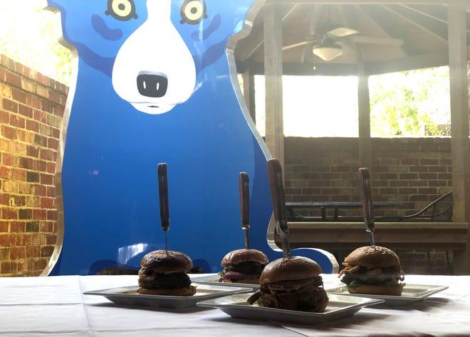 """Blue Dog Café unveiled four specialty burgers for its new """"Burger Night"""" menu."""