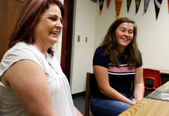 Michelle Peters, left, a government and history teacher at Millersport High School, and senior Sydney Tisdale, talk Wednesday, Sept. 11, 2019, about the candidate forum Peters' students have set up for individuals running for the Millersport Board of Education.
