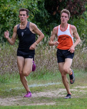 Plymouth's Carter Solomon (left) was first and Brighton's Jack Spamer was second in a dual meet on Tuesday, Sept. 10, 2019 at Huron Meadows Metropark.