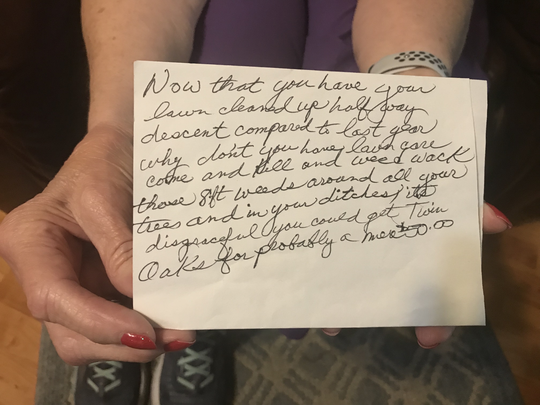 Janice Smith of Laingsburg said a snarky note left in her mailbox hurt her feelings. She shows the handwritten note Tuesday, Sept. 10, 2019.