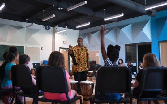 "Guest artist Greg Ince of ""Living Rhythms"" talks to students about African drumming Wednesday, Sept. 11, 2019, in the newly renovated choir room at Dwight Rich Academy."