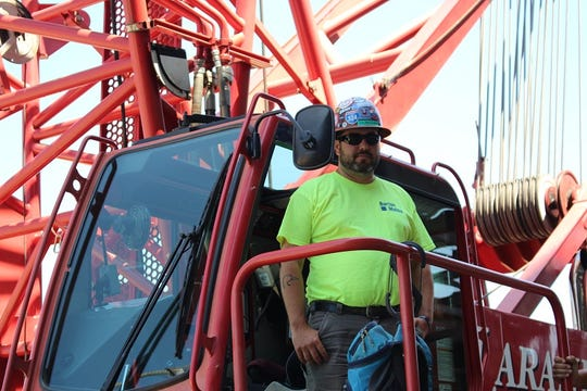 Crane operator Dylan Olson lifts thousands of pounds with a turn of his wrist.