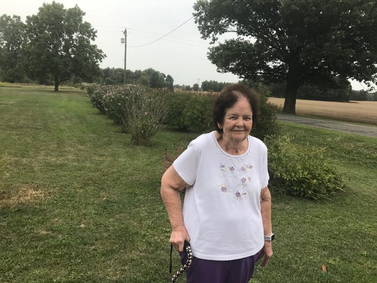 Janice Smith, 72, of Laingsburg said she was hurt by an anonymous note criticizing her lawn. Behind her on Tuesday, Sept. 10, 2019, are rows of Rose of Sharon and lilacs. Weeds in her ditches are now gone.