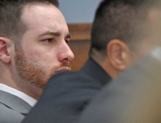 Guy Mitchell listens to Tuesday's testimony.