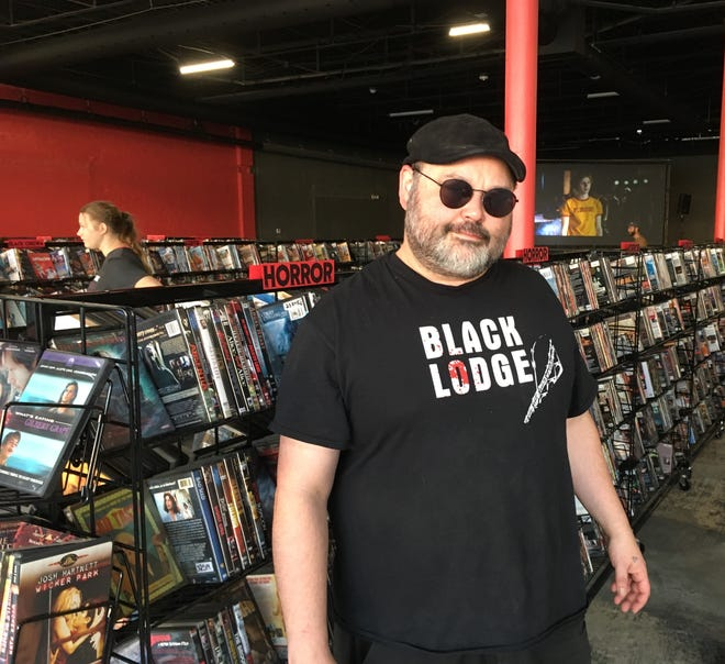 Owner Matt Martin stands inside the new Black Lodge. After a five-year hiatus, the Memphis movie rental store  reopened Friday, Sept. 6, 2019, at a new location near Crosstown Concourse.