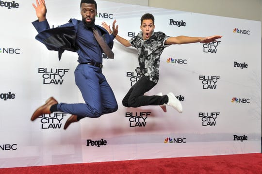 "Michael Luwoye, left, and Stony Blyden jump into action on the red carpet before the ""Bluff City Law"" premiere screening on Tuesday, Sept. 10, 2019, at the Halloran Centre in Downtown Memphis."