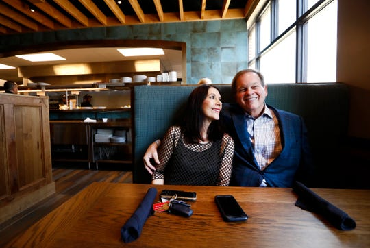 Tommy and Liz Peters, the husband and wife duo who own Moondance Grill in Germantown, pose for a photo in their new restaurant.