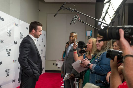 "Barry Sloane talks to reporters before the ""Bluff City Law"" premiere screening on Tuesday, Sept. 10, 2019, at the Halloran Centre in Downtown Memphis."