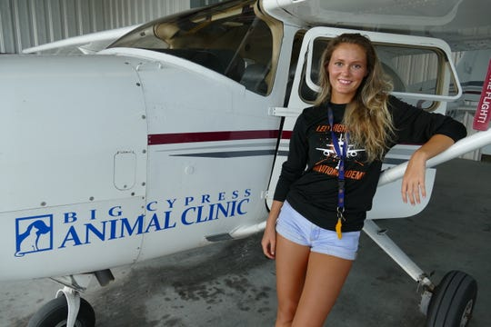 Andi Miller looks at the camera after returning from Abaco Islands in Bahamas on Sept. 10, 2019. The 19-year-old licensed pilot flew a Cessna 182 full of pet supplies from Naples Airport after Hurricane Dorian decimated the island.