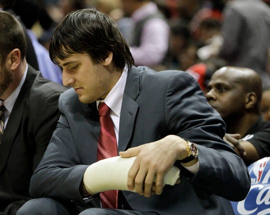 Milwaukee Bucks' Andrew Bogut stretches his arm on the bench during game against the Atlanta Hawks at the Bradley Center, Saturday, April 25, 2010.