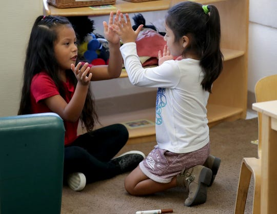 Preschoolers Exayana Bedolla, left, and Vanessa Serrano play at El Hogar del Niño, a Head Start center on South Loomis Street in Chicago on Thursday, Aug. 15, 2019.